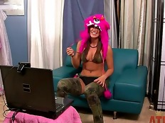 Naughty Rilynn Rae all dressed up and indoors doesnt ground her to not satisfying her fans as she gets on her laptop into a webcam show on the couch to show of what she got